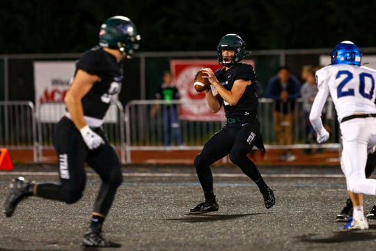 Titans' Jackson Lowery (5) looks to make a pass in the Grant vs. West Salem football game at West Salem High School on Sept. 20, 2019. The West Salem Titans hosted the Grant Generals, defeating them 23-13.