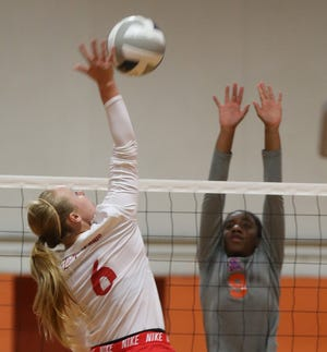 Skyler Brooks, left, spikes the ball for Miles during a tournament earlier in the season in this August 16, 2019 photo.