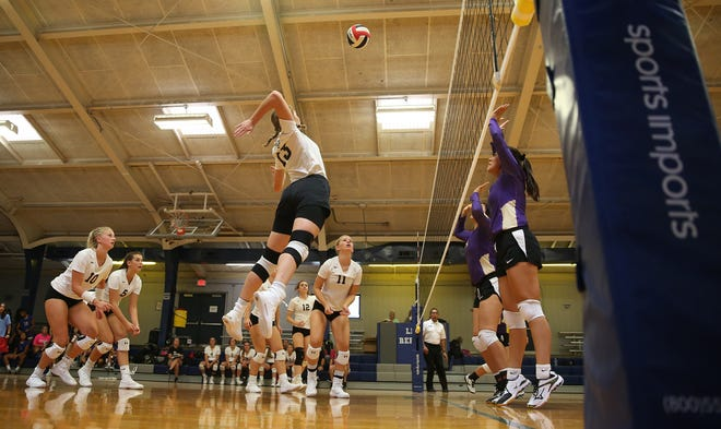 Kendra Hoover, center, gets set to spike the ball for Water Valley in this August 16, 2019 photo.