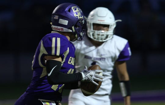 Kamden Pruitt, left, prepares to throw a pass for Sterling City against Irion County on Friday, Sept. 20, 2019.