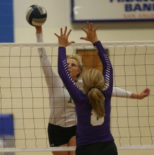 Micki Mead, right, attempts to block a shot for Sterling City during a tournament early in the season in this August 16, 2019 photo.