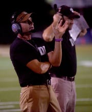 Bossier head coach Mike Concilio (left) and the Bearkats are 4-0.