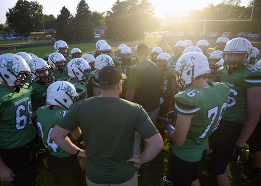 McCook Central/Montrose coach Shawn Flanagan talks to his time prior to a game against Bridgewater-Emery/Ethan on Friday, Sept. 20, in Salem.