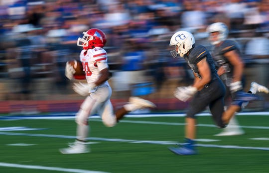 Lincoln running back Isaiah Robinson (20) runs the ball during the game at O'Gorman on Friday, Sept. 20, 2019.