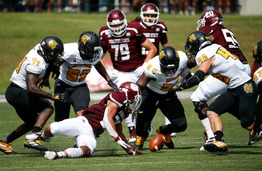 Missouri State and Kennesaw State defenders dive to recover a fumble during a game at Plaster Field on Saturday, Sept. 21, 2019.