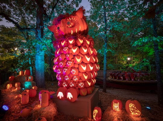The Pumpkin Nights lighting effects are striking, with colored lights washing over the treetops, rides and buildings of Silver Dollar City.
