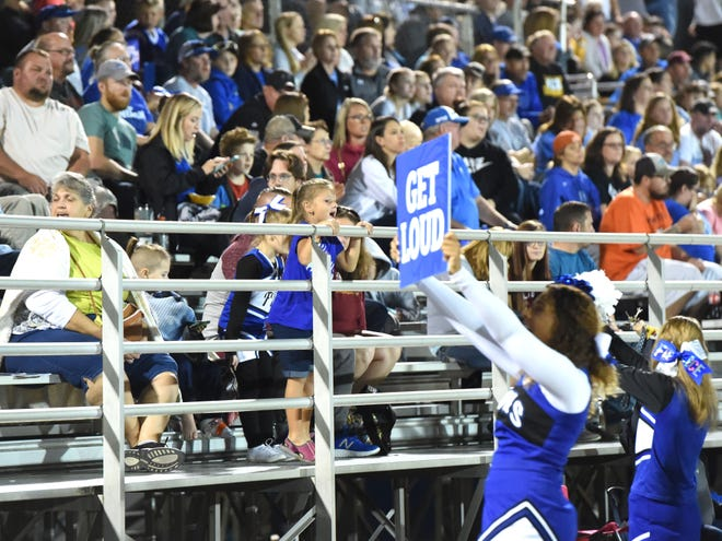 The Fort Defiance cheerleader encourage the fans to get loud.