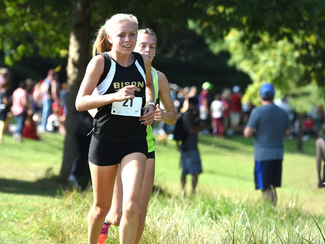 Buffalo Gap's Annika Fisher and Wilson Memorial's Eliza Dana battle for the lead early in this year's Augusta County Cross Country Invitational in Fishersville. Fisher eventually won the race.
