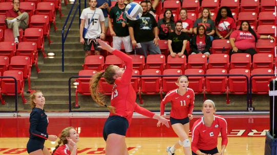 Dixie State's Megan Treanor goes for a spike.