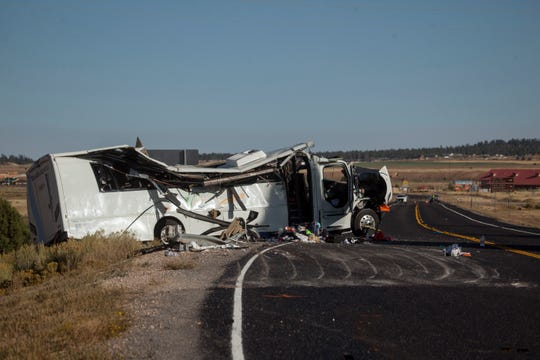 Troopers from the Utah Highway Patrol investigate a fatal bus crash near Bryce Canyon National Park Friday, Sept. 20, 2019.