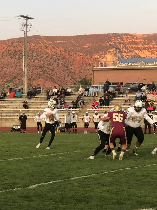 Desert Hills QB Logan Wilstead drops back to pass during the Thunder's 56-55 win in double overtime over the Cedar Reds on Sept. 21, 2019.