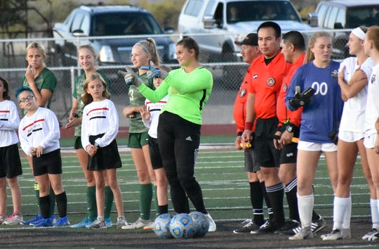 Snow Canyon's Meg Rodgers gives the sidelines the classic finger guns before the Warriors played Desert Hills.