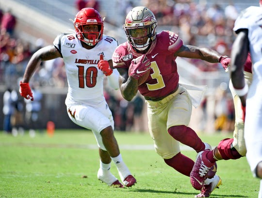 Sep 21, 2019; Tallahassee, FL, USA; Florida State Seminoles running back Cam Akers (3) runs the ball past Louisville Cardinals linebacker Rodjay Burns (10) during the first half at Doak Campbell Stadium. Mandatory Credit: Melina Myers-USA TODAY Sports