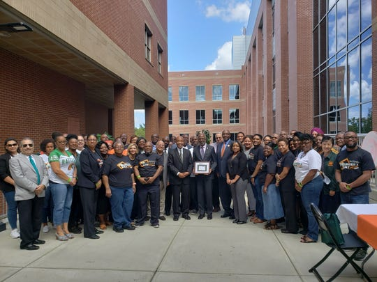Florida A&M University President Larry Robinson, center, attends Friday, Sept. 20 celebration at the College of Pharmacy and Pharmaceutical Sciences.