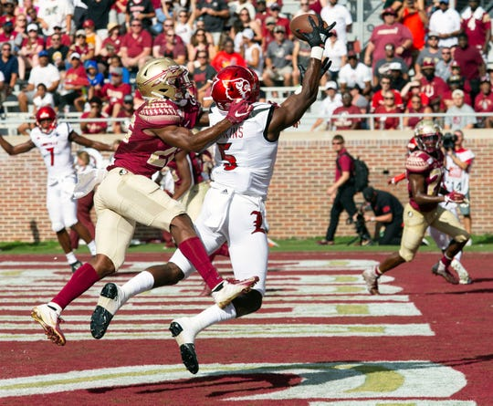 Florida State defensive back Asante Samuel Jr. (26) gets called for pass interference defending Louisville wide receiver Seth Dawkins (5) in the first half of an NCAA college football game in Tallahassee, Fla., Saturday, Sept. 21, 2019.