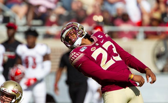 Florida State place kicker Ricky Aguayo (23) watches a 51 yard field goal attempt sail wide left in the first half of an NCAA college football game against Louisville in Tallahassee, Fla., Saturday, Sept. 21, 2019.