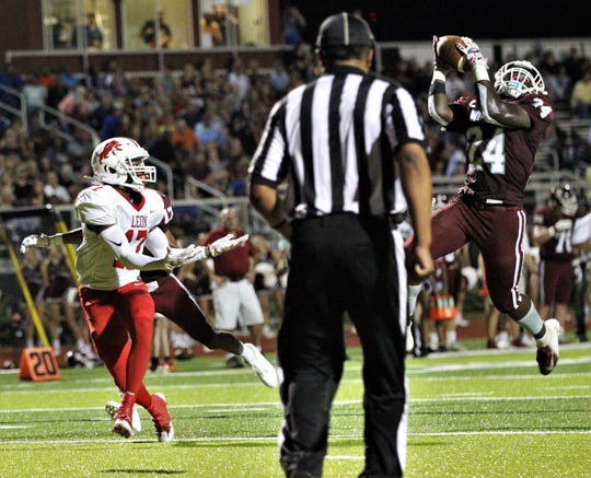 Chiles safety Devin Harrell makes a leaping interception in the red zone as Chiles beat Leon 37-20 on Friday, Sept. 20, 2019.