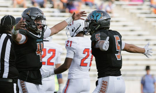 Pebble Hills quarterback Sebastian Ochoa celebrates his rushing touchdown with teammate Jalen Partida Friday during their game against San Angelo Central Friday.