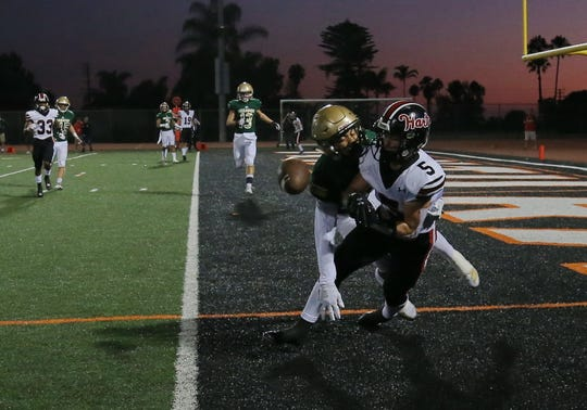 St. Bonaventure High's Ryeon Morales breaks up a potential touchdown pass to Hart High's Ryan Tomaszewski during Friday night's game at Ventura College. St. Bonaventure lost, 34-28.
