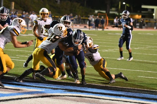 Camarillo High's Jessie Valenzuela bullies his way into the end zone during the Scorpions' 48-21 victory over Ventura on Friday night at Moorpark College.