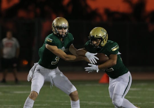 Quarterback Gavin Beerup, left, and running back Justin Cantu lead St. Bonaventure into its key Marmonte League opener against Newbury Park at Ventura College on Thursday night.