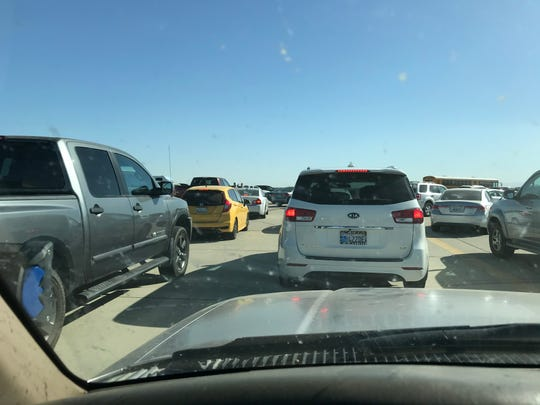 Traffic stretch miles down Highway 198 as many disappointed attendees waited three hours or more to enter Naval Air Station Lemoore to see the  Blue Angels' fly in their long-awaited Valley return on Saturday, Sept. 21.