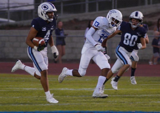 CVC's Jaalen Rening takes the opening snap 76 yards for the touchdown as Immanuel comes into Visalia for a non-league football game against CVC.