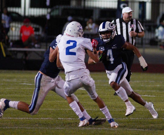 CVC's Jaalen Rening gains positive yards off the option pass from quarterback Tyce Griswold against Immanuel Friday night during a non-league football game against CVC.