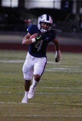 CVC's Jaalen Rening gains positive yards against Immanuel Friday night during a non-league football game against CVC.