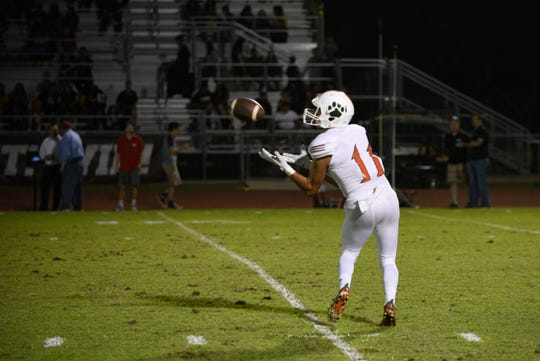 Porterville's Jovanie Cardenas hauls in a pass and turns it into a touchdown against Golden West in a non-league high school football game at Visalia Community Stadium on Friday, Sept. 20, 2019.