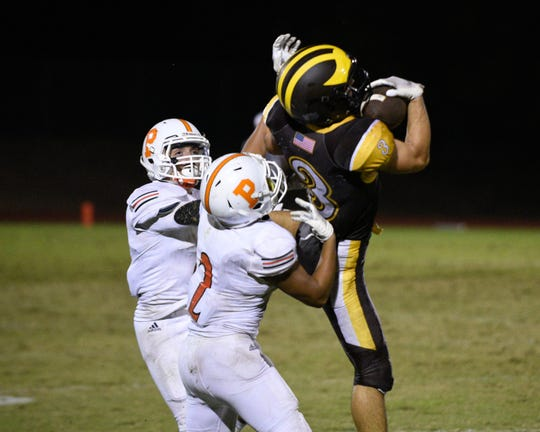 Golden West's Michael Wessel hauls in a pass against Porterville in a non-league high school football game at Visalia Community Stadium on Friday, Sept. 20, 2019.