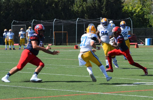 Stepinac wideout Myles Walker turns back into the middle of the field, takes advantage of a Michael Tartaglia block and goes 23 yards for a touchdown during a 48-14 win over St. Peter's on Sept. 21, 2019 at Archbishop Stepinac High School in White Plains.