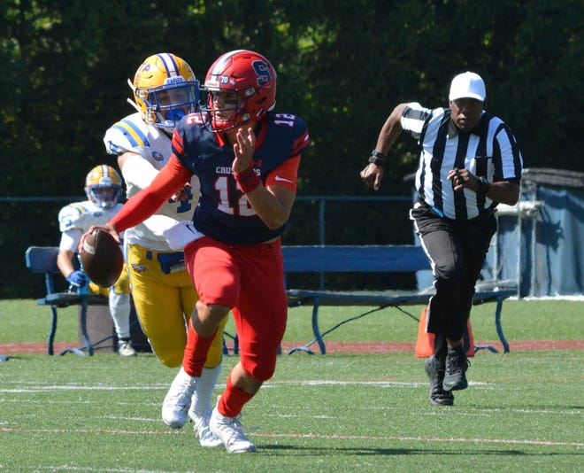 Stepinac quarterback Joey Carino scrambles for positive yardage during a 48-14 win over St. Peter's on Sept. 21, 2019 at Archbishop Stepinac High School in White Plains.