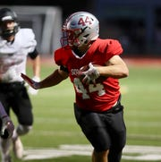 Somers' Jack Kaiser runs in for a touchdown against Rye.