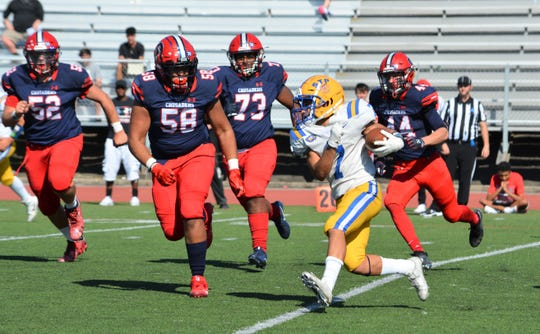 Stepinac defensive end Darius Underwood (58) closes in on St. Peter's receiver Michael Politi during the Crusaders' 48-14 win on Sept. 21, 2019 at Archbishop Stepinac High School in White Plains.