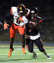 Spring Valley's Chris White (7) tackles White Plains' Josiah Harris (8) in a football game at Spring Valley High School on Sept. 20, 2019.