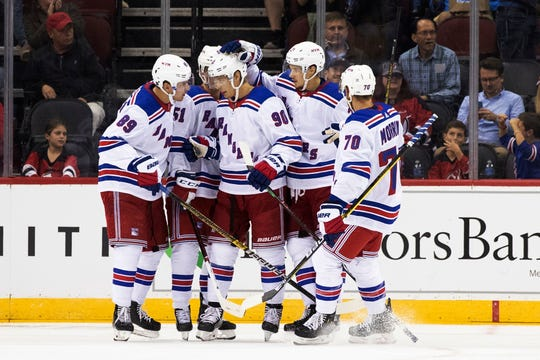 New York Rangers center Vladislav Namestnikov celebrates his goal with teammates during the second period of a preseason NHL hockey game against the New Jersey Devils, Friday, Sept. 20, 2019, in Newark, N.J.