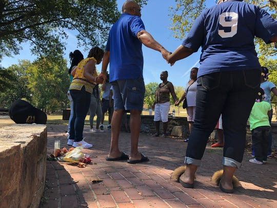 A memorial was put together in the center of Cool Spring Park where a 21-year-old man was shot and killed Monday. Community members gathered there for a prayer service Saturday.