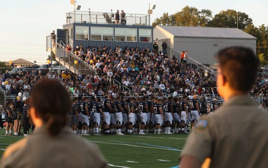 Delaware Military Academy students line Fusco Memorial Field as the school's new artificial turf stadium is officially opened in ceremonies Friday before the home team beat Red Lion Christian Academy.
