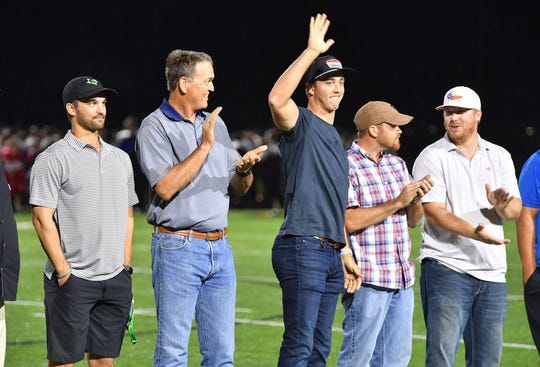 Case McCoy waves as he and other members of the Graham 2009 state runnerup team is honored at halftime Friday night.
