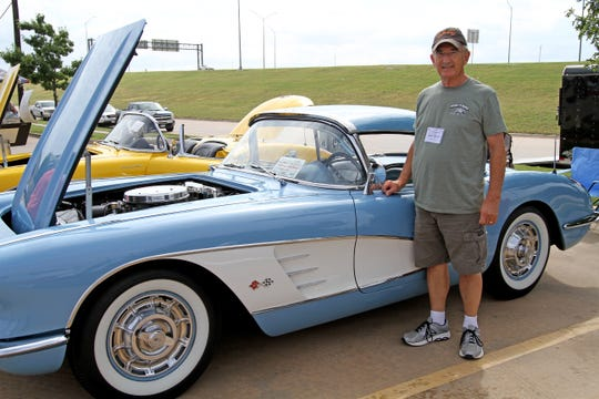 David Holcomb poses with his 1960 Corvette Saturday, Sept. 21, 2019, at the Wichita County Corvette Association's 34th Annual North Texas Corvette Roundup in the Holiday Inn Express parking lot.