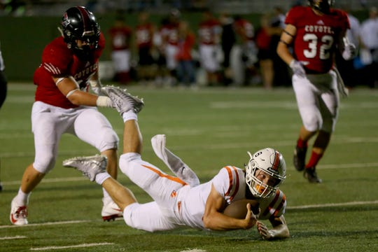 Burkburnett quarterback Mason Duke dives for extra yards Friday against Wichita Falls High at Memorial Stadium.
