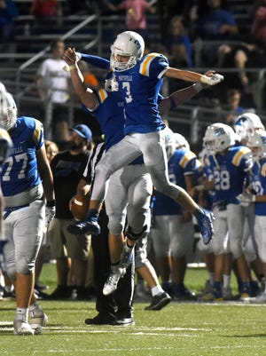 Kaiden Hartman celebrates with Easton Smith after securing Maysville's 21-13 win against visiting New Lexington on Friday night in Newton Township.