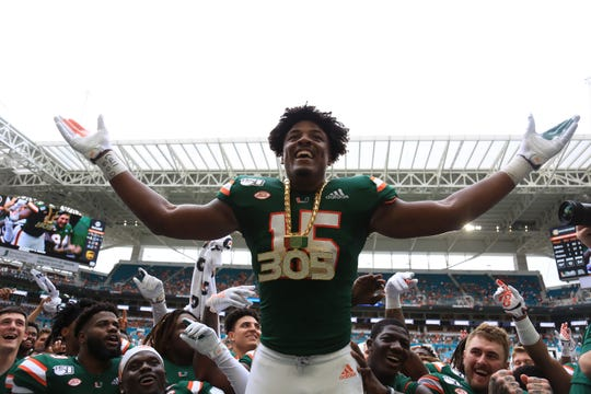 Miami Hurricanes defensive lineman Gregory Rousseau wears the turnover chain during the game against the Central Michigan Chippewas at Hard Rock Stadium.