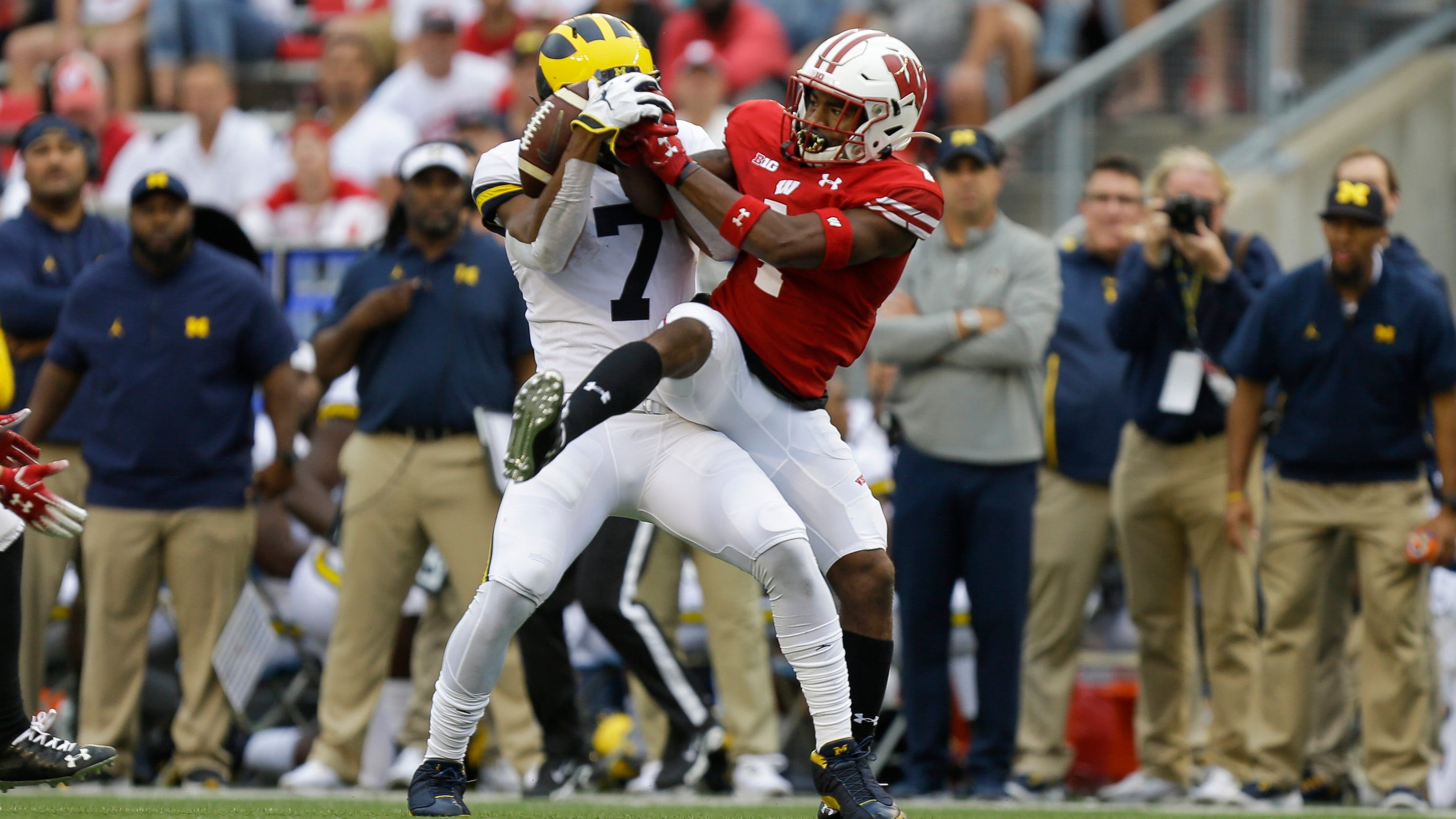 Michigan showed it is a pretender, while Wisconsin joined the College Football Playoff contenders