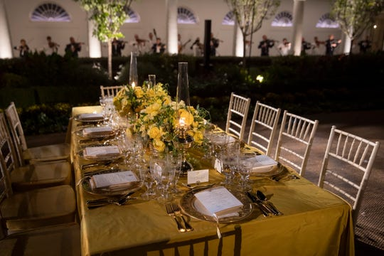 A table is set and a U.S. military string band plays during a media preview of the state dinner for Australia Prime Minister Scott Morrison, taking place in the Rose Garden of the White House Sept. 20, 2019.
