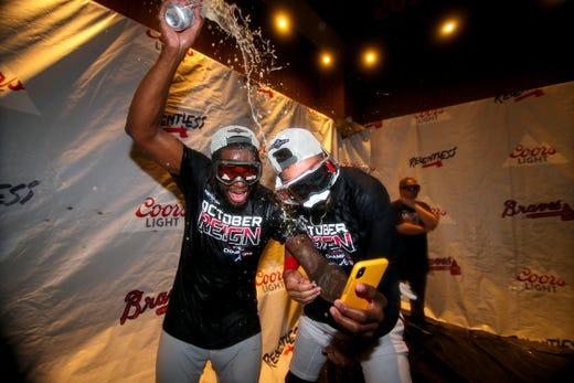 September 20: Brave pitcher Touki Toussaint and center defender Billy Hamilton celebrate.