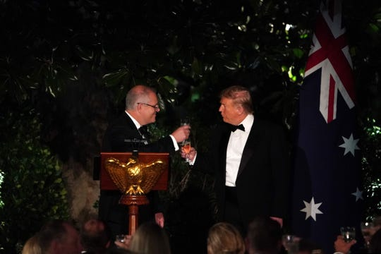 President Donald Trump and Australian Prime Minister Scott Morrison toast during an Official Visit with a State Dinner at the Rose Garden of the White House in Washington, DC, September 20, 2019.