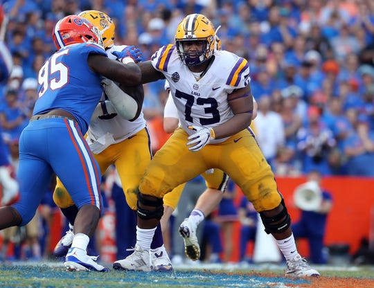 LSU offensive lineman Adrian Magee (73) looks to make a block against Florida during their game in 2018.