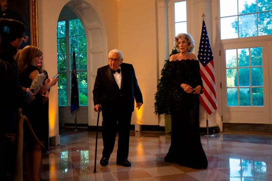 Former Secretary of State Henry Kissinger and his wife Nancy arrive at the White House to attend a state dinner honoring Australian Prime Minister Scott Morrison on Sept. 20, 2019.